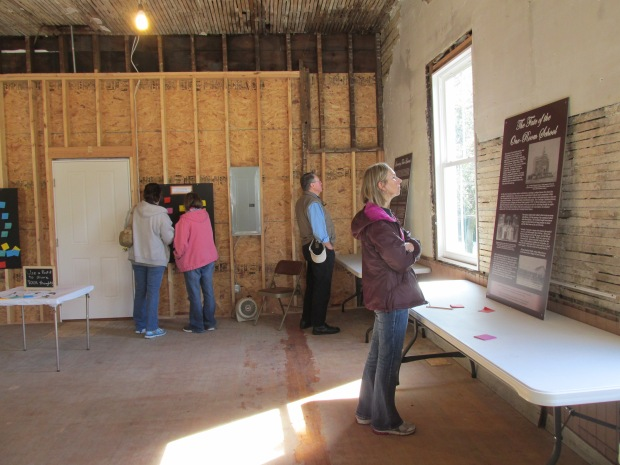 Visitors to the Stewart School exhibit at Stow Historical Society's Harvest Festival, October 4, 2015